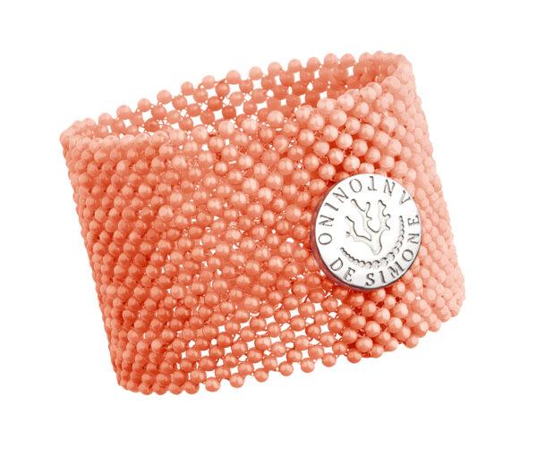 Bracciale tessito corallo rosa del Pacifico e bottone argento bianco