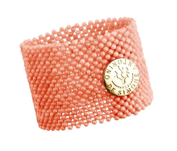 Bracciale tessito corallo rosa del Pacifico e bottone argento dorato