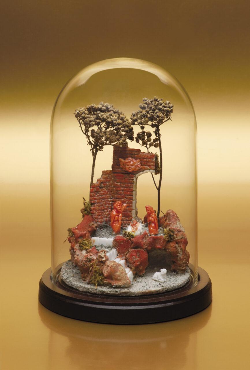 Presepe artigianale in corallo bianco e rosso e pietra lavica
